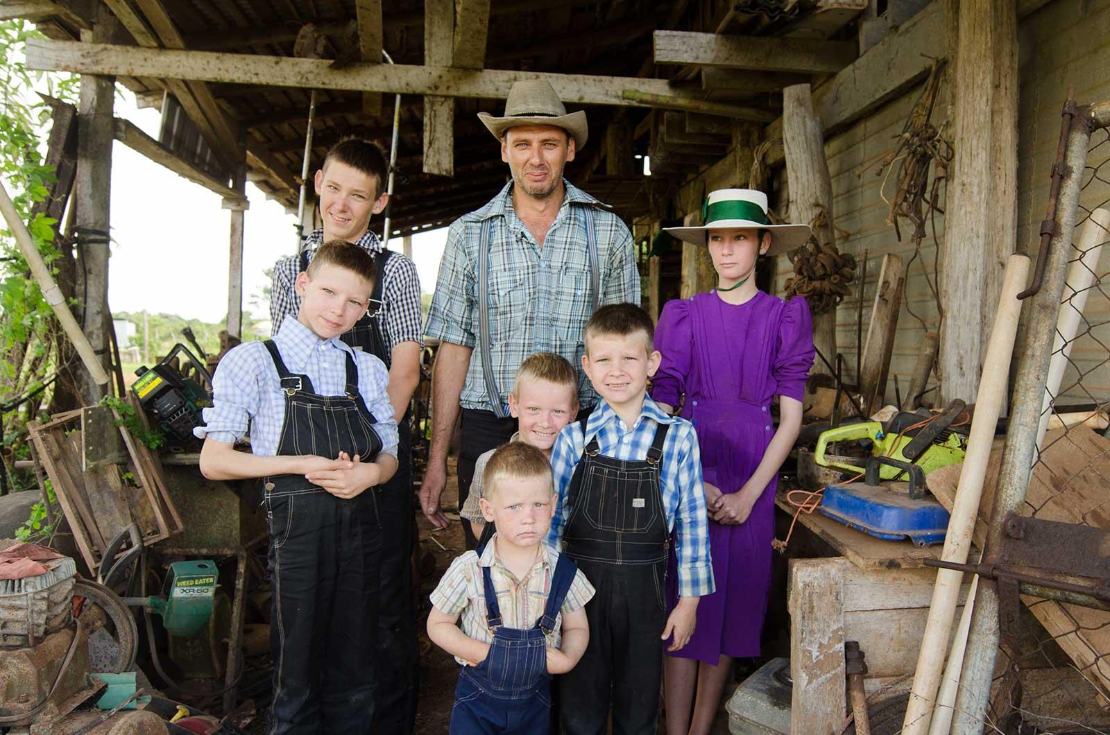 Mennonite man and his children, Orange Walk, Belize